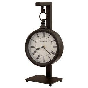 Howard Miller Loman metal clock on a stand